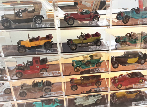 matchbox models of yesteryear cars in display case
